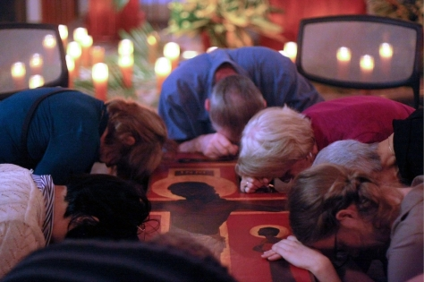 People Praying Around Taize Cross